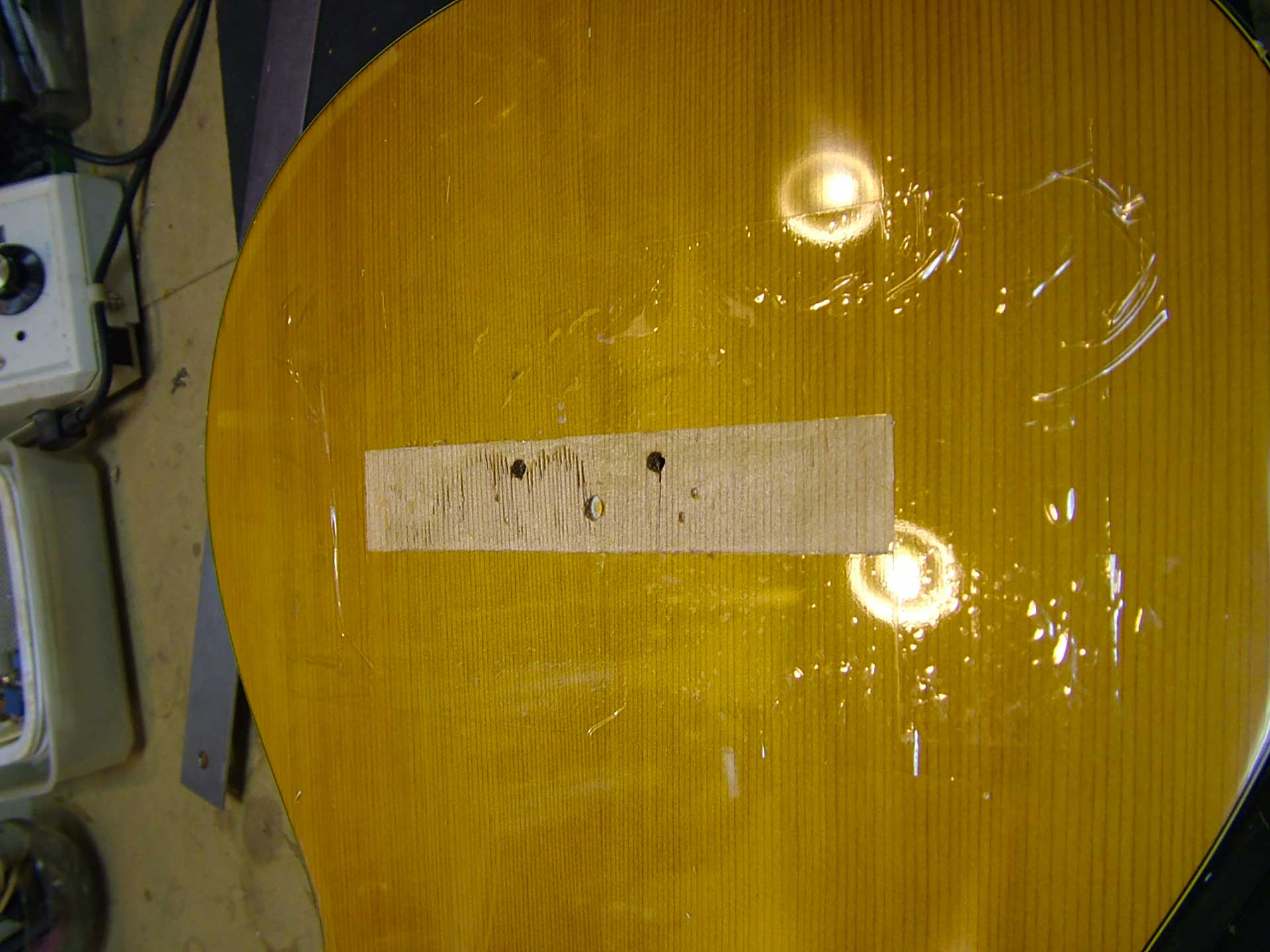 Example of repair performed in the workshop on a classical guitar